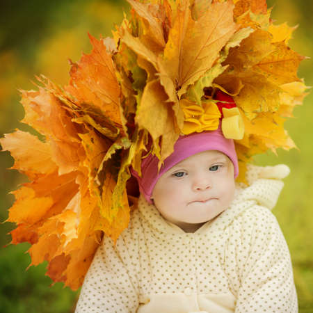 Girl with Down syndrome wore a wreath of spring leaves Stock Photo