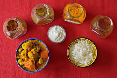 Spicy vegetable curry with semi-brown basmati rice and raita sauce