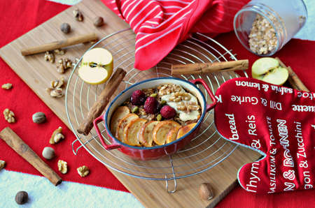 Oven baked apple pie oats with cinnamon and ginger spices, topped with cashew butter, walnuts, raspberries, pistachio and maple syrup.
