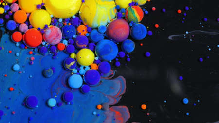 Multicolored Bubbles Of Bright Collors Moving In Paint Oil Surface Beautiful Blue Universe Of Color Slow Motion Macro Red Blue Black And Yellow.