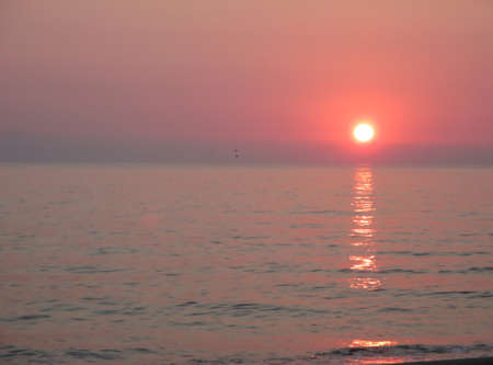 sunset over the sea in Italy