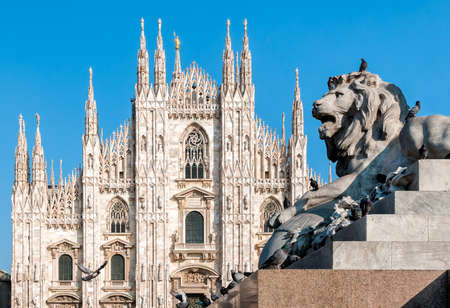 Milan Cathedral with monument of lion 스톡 콘텐츠