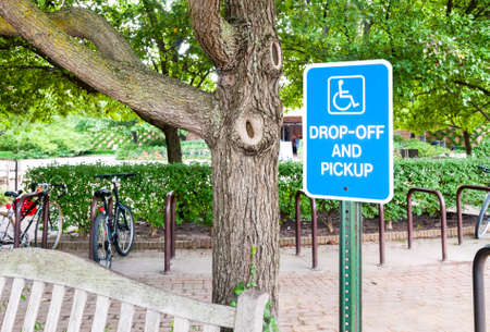 dropoff: Handicapped parking sign for disabled drivers and wheelchair space