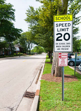 shool: Shool zone speed limit 20 mile sign, when children are present