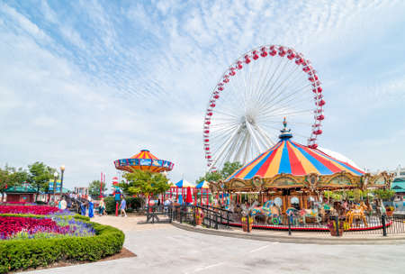 theme park: CHICAGO, UNITED STATES - AUGUST 24, 2015: Tourists at the amusement park on Navy Pier