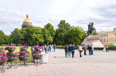 senate: SAINT PETERSBURG, RUSSIA - JUNE 11, 2015: Tourists visiting Senate Square with Monument to Emperor Peter I the Great