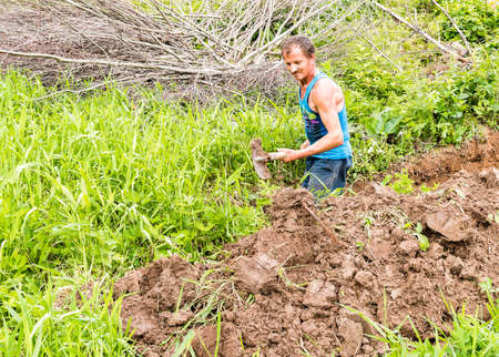 digging: Man digging the ground with a spade