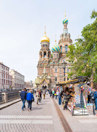 savior: SAINT PETERSBURG, RUSSIA - JUNE 15, 2015: Church of the Savior on Spilled Blood, with tourists and souvenir stands in front.