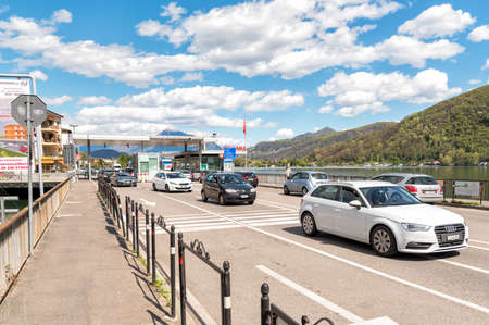 schengen: PONTE TRESA, ITALY - APRIL 16, 2016: Bridge with Border Checkpoint between Italy and Switzerland, where travelers or goods are inspected. Editorial
