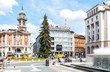 regime: VARESE, ITALY - MAY 6, 2016: Monte Grappa square, located in the historic center. A tall fir tree and the streaming fountain dominated the square. It was built in 1927 under fascist regime, Varese When Became provincial capital. Editorial