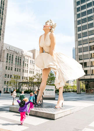 monroe: Chicago, IL, United States - April 13, 2012: Forever Marilyn Monroe Sculpture along Michigan avenue, visited by large numbers of tourists.