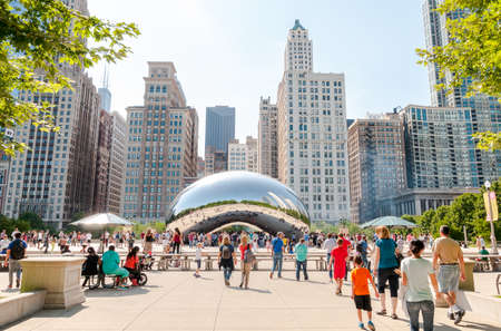 Chicago, IL, United States - August 15, 2014: Cloud Gate, one of the most unique and interesting sculptures in decades graces the promenade at Chicagos Millennium Park. Editorial