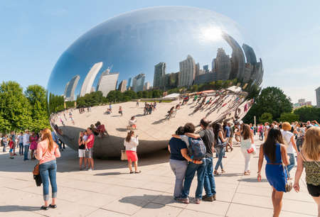 decades: Chicago, IL, United States - August 15, 2014: Cloud Gate, one of the most unique and interesting sculptures in decades graces the promenade at Chicagos Millennium Park. Editorial