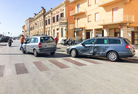 assessments: Trapani, Italy - October 4, 2016: Car accident in the city center with police in assessments.