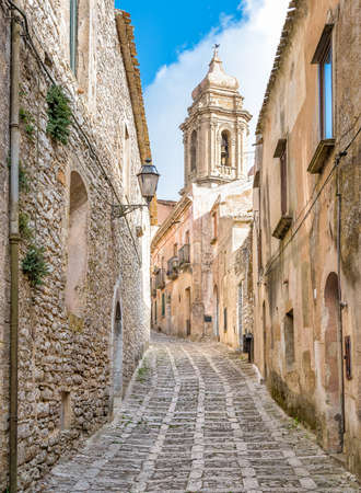 erice: The narrow street of Erice with the church tower in the background, Sicily, Italy