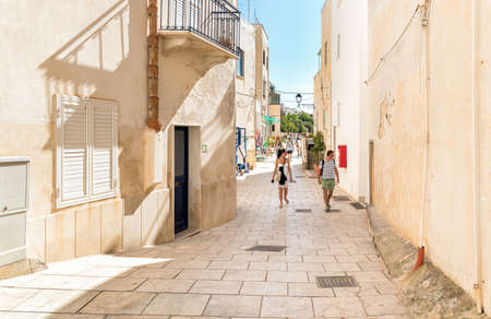 levanzo: Levanzo, Trapani, Italy - 22 September 2016: Visitors enjoy the coastline During Their trip of small village on Levanzo island, the smallest of the Egadi.