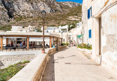 Levanzo, Trapani, Italy - 22 September 2016: Visitors relax and enjoy the coastline During Their trip at the restaurant of the small village on Levanzo island, the smallest of the Egadi.