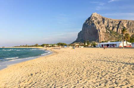 Tourists enjoy mediterranean sea in the famous San Vito Lo Capo beach. Trapani, Italy Stock Photo