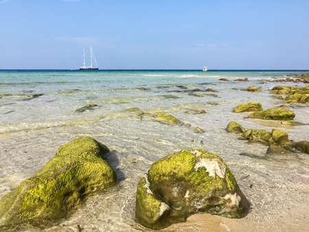 capo: Landscape of mediterranean sea with stones, yachts and ship, San Vito Lo Capo, Sicily Stock Photo