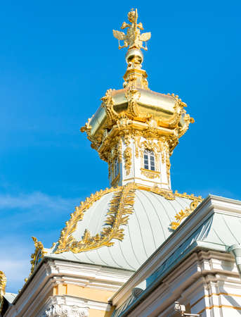 Golden dome with three headed eagle of the Grand Peterhof Palace, Saint Petersburg, Russia