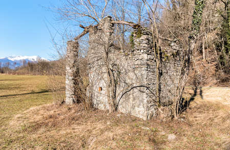 Abandoned stone building in rural area.