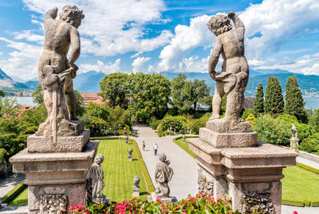 Stresa, Verbania, Italy - July 28, 2016: People visiting park Beautiful garden of island, is one of the Borromean Islands of lake Maggiore Piedmont of north Italy