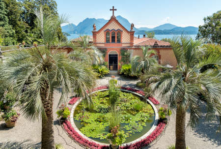 Park Family Chapel with garden and pool on Mother Island, is one of the Borromean Islands of lake Maggiore Piedmont of north Italy Standard-Bild