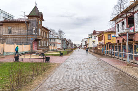 Arkhangelsk, Russian Federation - May 24, 2017: Pedestrian Chumbarova-Luchinskogo Avenue, an open-air museum with wooden houses, benches and monuments in Arkhangelsk.