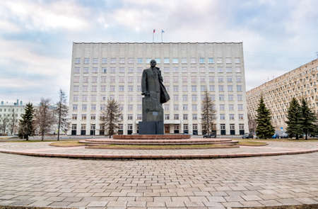 Monument to Vladimir Ilyich Lenin with the building of a regional council of deputies in background in Arkhangelsk, Russia
