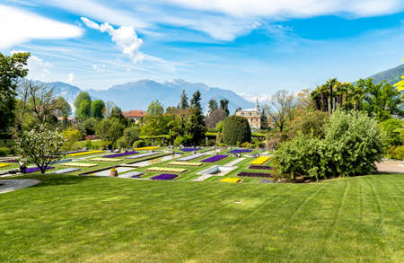 Landscape of Botanical Gardens of Villa Taranto with colorful flowers and palms, located on the shore of Lake Maggiore in Pallanza, Verbania, Italy. Stock Photo