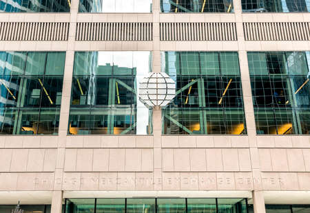 Chicago, Illinois, USA - August 16, 2014: Background of the Chicago Mercantile Exchange facade with logo, is an office complex of two towers in Chicago.