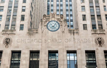 Chicago, Illinois, USA - August 23, 2014: Facade of a Board of Trade Building with a clock along LaSalle Street in Chicago.