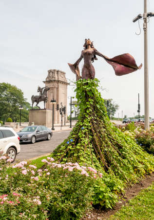 Magdalene Sculpture is located on the small triangular landscape at the intersection of Congress Parkway and Michigan Avenue in Chicago. Stock Photo