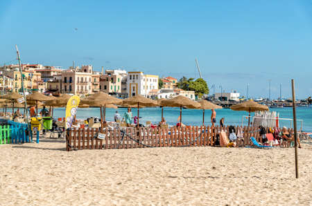 People enjoying the beach of Mondello on an autumn day, is a small seaside resort near Palermo city center.