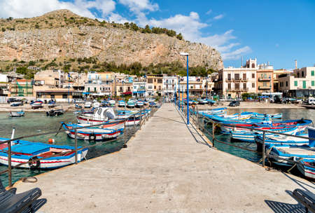 Small port with fishing boats in the center of Mondello.