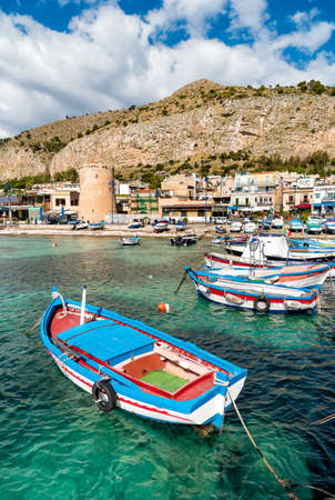 Small port with fishing boats in the center of Mondello, Palermo, Italy Stock Photo