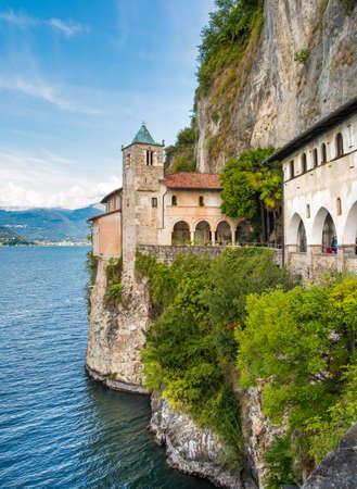 Hermitage of Santa Caterina del Sasso, is rock face directly overhanging the lake Maggiore, Leggiuno, Italy 스톡 콘텐츠