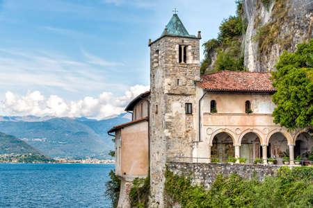 Hermitage of Santa Caterina del Sasso, is rock face directly overhanging the lake Maggiore, Leggiuno, Italy Stock Photo