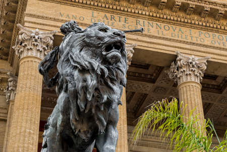 Lion statue in front of the Massimo Vittorio Emanuele Theater in Palermo, Sicily, Italy. Editorial