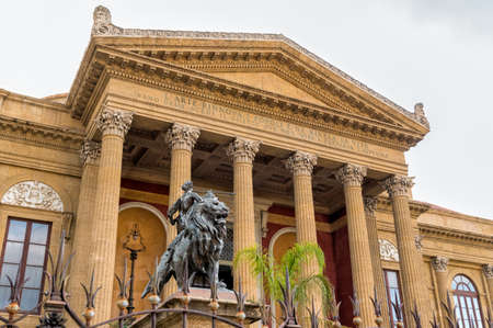 Front of the Theater Massimo Vittorio Emanuele with lion statues in Palermo, Sicily, Italy.