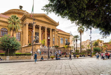 Tourists in front of the famous opera house Theater Massimo Vittorio Emanuele in Palermo, Sicily, Italy