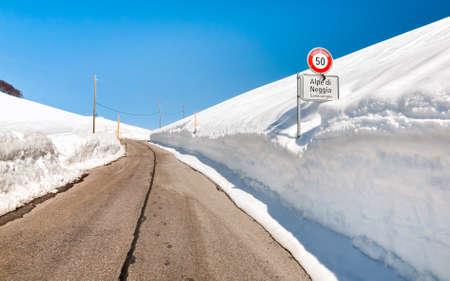 Alpe di Neggia, Gambarogno road with high snow accumulation, Ticino, Switzerland