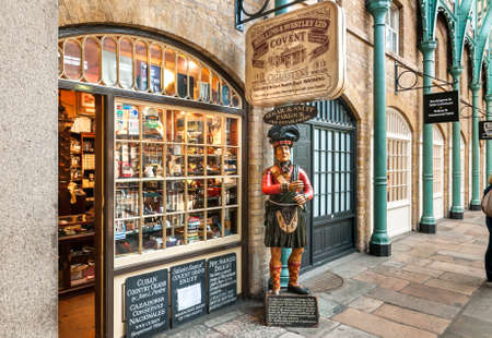 Segar and Snuff Parlor shop with traditional Highlander statues stands guard near entrance, in the Covent Garden Market in London.