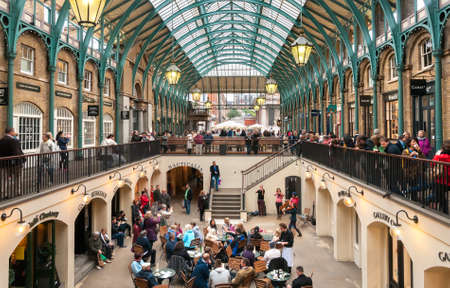 People visiting Covent Garden Apple Market, is the big attraction for its restaurants, pubs, market stalls and shop in London. Editorial