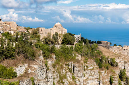 View of the Church of St. John the Baptist and Hormanno Castle and Balio Towers Castle in Erice, Sicily, Italy Stock Photo
