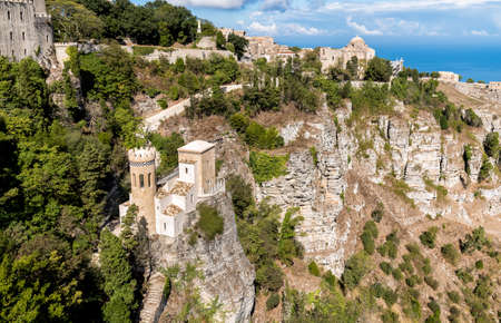 View of little castle Pepoli tower and Church of St. John the Baptis in Erice, province of Trapani in Sicily, Italy