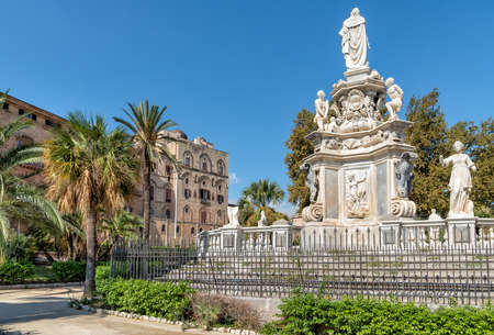 View of Monument to King Philip V of Spain in the Villa Bonanno and Norman Palace in the background, Palermo, Italy