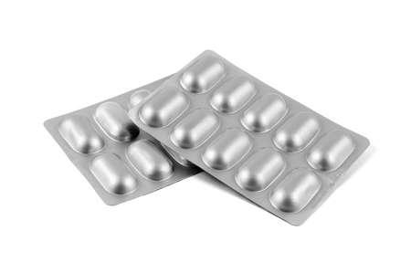 Medicine pills in aluminum foil strip isolated on white background. 版權商用圖片