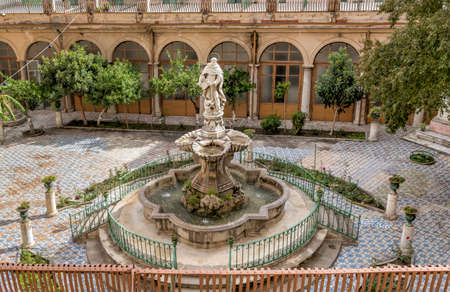 The majolica cloister with fountain in the courtyard of the Santa Caterina church, Palermo, Italy. Banco de Imagens