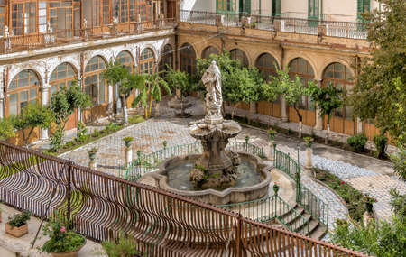 The majolica cloister with fountain in the courtyard of the Santa Caterina church, Palermo, Italy. Éditoriale